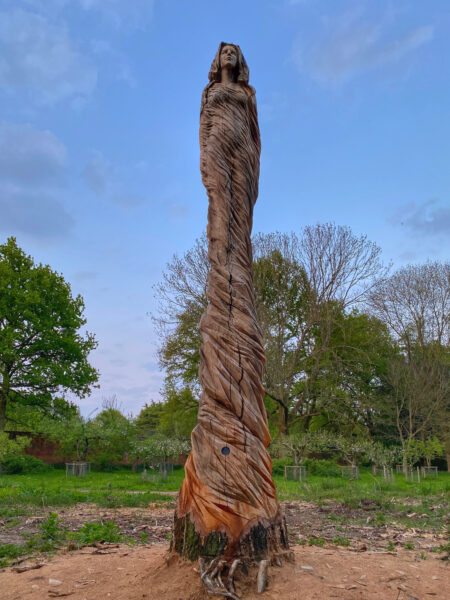 The marbury lady elm sculpture by Simon O'Rourke. One of several free public tree carving sculptures to see this bank holiday weekend