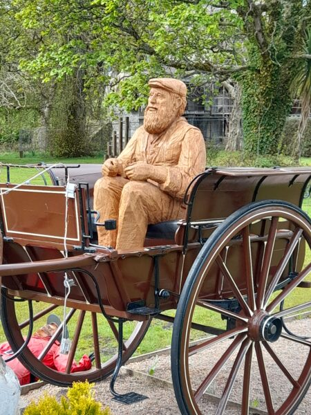 Simon O'Rourke's Lews Castle Carriage Driver sitting in the antique cart at Lews Castle