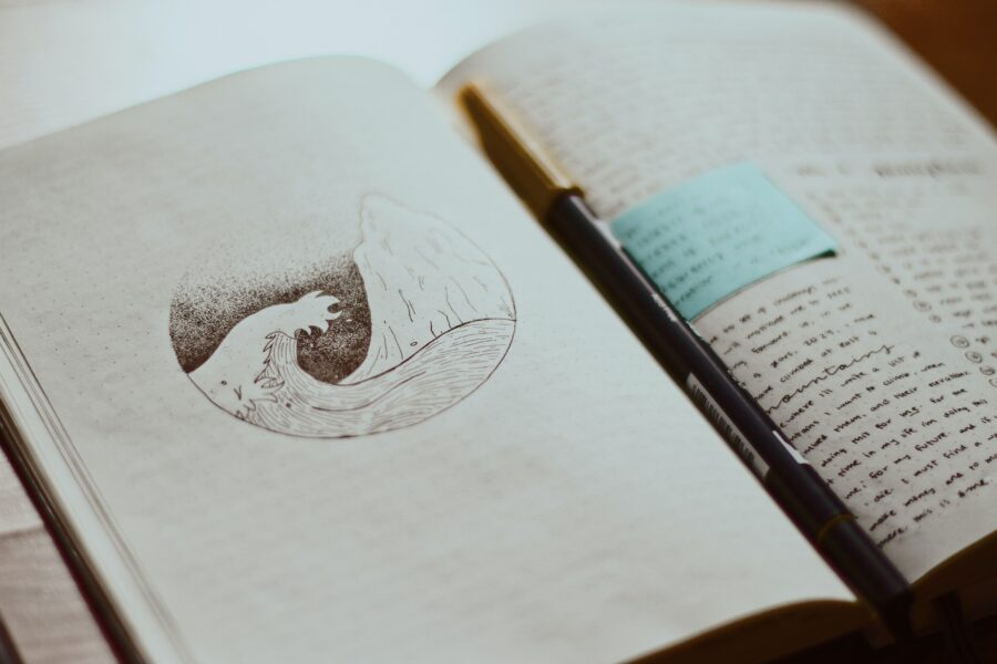 Open jounrla with a sketch and writing to reflect The Impact of Creativity and Art on Mental Health