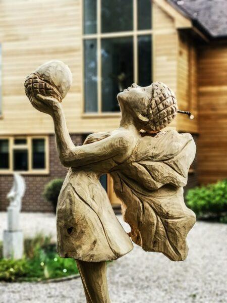 """""""The Offering"""" an oak fairy sculpture in cedar by simon o'rourke"""