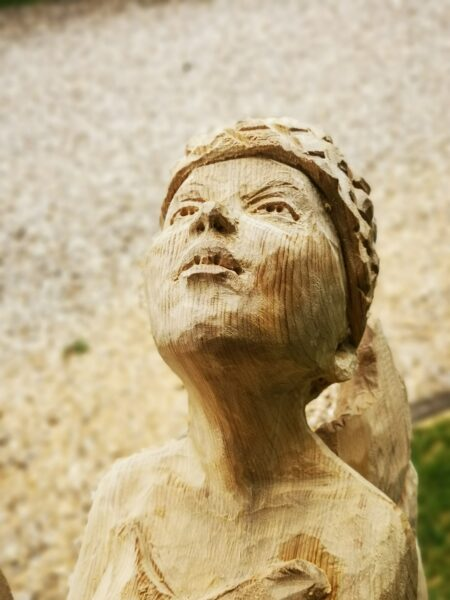 close up of the face of simon o'rourke's oak fairy sculpture