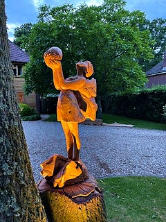 oak fairy sculpture by simon o'rourke by night.