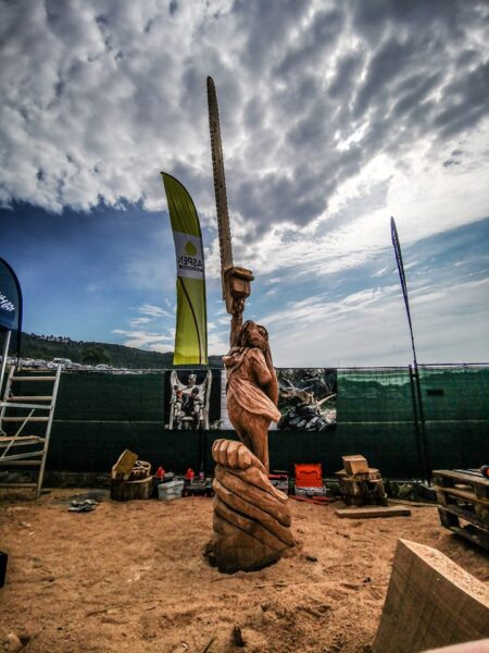 top chainsaw carving events include holz flor and friends. photo shows a scene from that event including a moon hare sculpture by simon o'rourke
