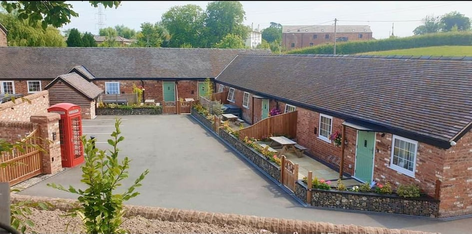 Lower Farm holiday cottages courtyard view. The site of the lower farm sculpture trail