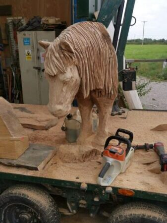 shetland pony from the lower farm sculpture trail on the back of a truck